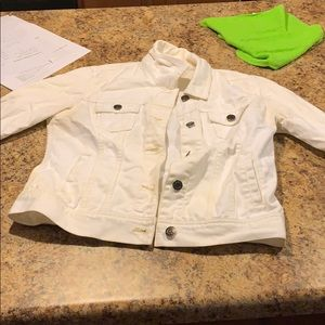White jean jacket has a few stains